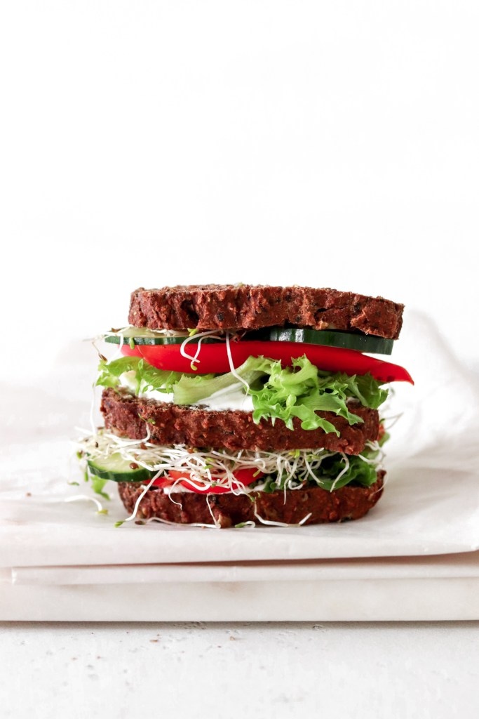 Cream Cheese & Vegetable Sandwich (Vegetarian & Gluten Free) From Front On A Cutting Board