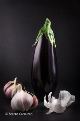 Aubergine with garlic and dark background