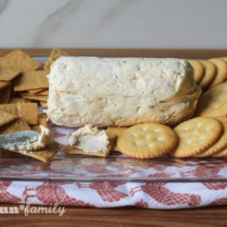 The best cheese log recipe for the holidays and beyond. This is a family favorite holiday appetizer, along with crackers. We have it at each holiday gathering!