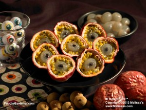 Zombie eyeballs made with stuffed passion vine fruit shells, grapes and pomegranate seeds