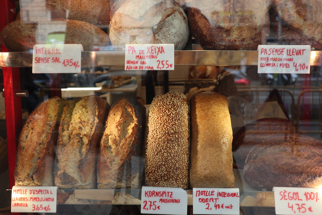 Baked bread in the window at Forn Mistral