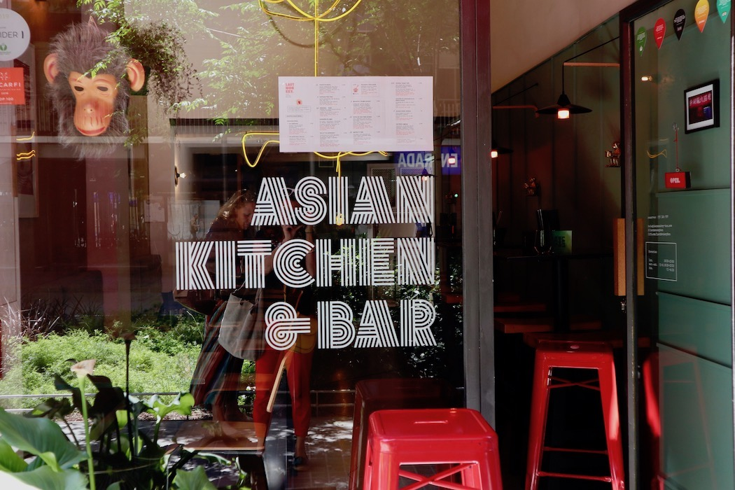 The outside window of Last Monkey Asian Kitchen and Bar