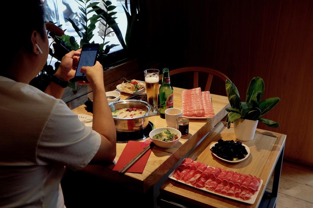 A man having lunch at Chiongqing Liuyishou Hotpot