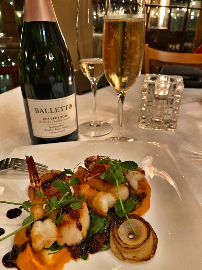 Pan Seared Diver Scallops & Gulf Prawns, paired with a local Brut 2015 Sparkling Rose