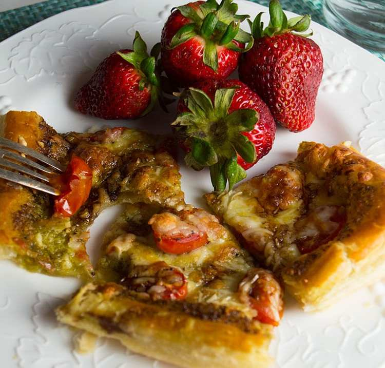 Tomato tart with pesto and mozzarella gets a flavor boost from balsamic glaze.
