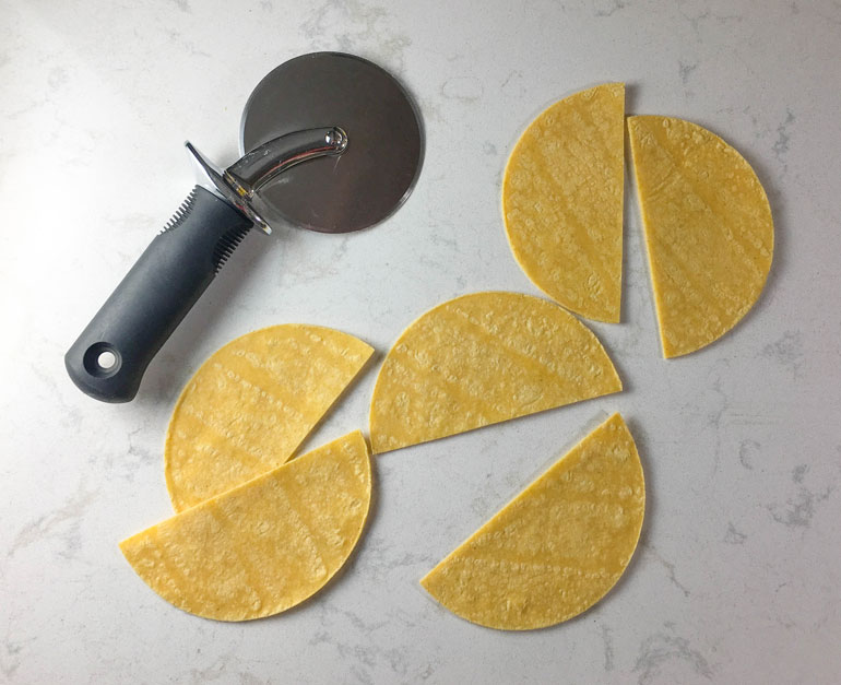Cutting corn tortillas in half makes bean and chorizo tostadas into a hand-held party food.