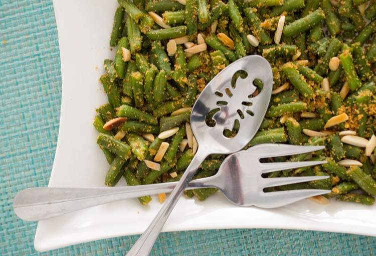 Easy green beans with breadcrumbs, almonds and garlic come together in 15 minutes with just a few basic ingredients.