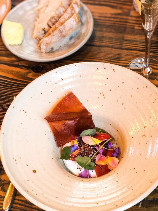 Italian Tomatoes, Charred Watermelon, Goats' Curd, Kaniwa, Fresh Edible Flowers and Red Pepper Tuile -Adelina Yard, Bristol