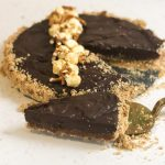 Slice of Pretzel and Popcorn Chocolate Salted Caramel Tart - www.foodnerd4life.com