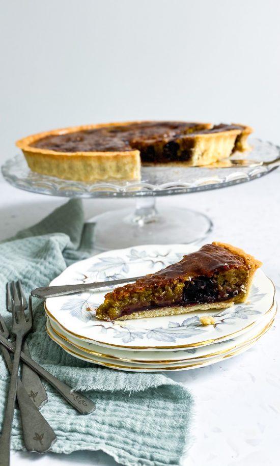 Slice of Pistachio and Cherry Frangipane Tart - www.foodnerd4life.com