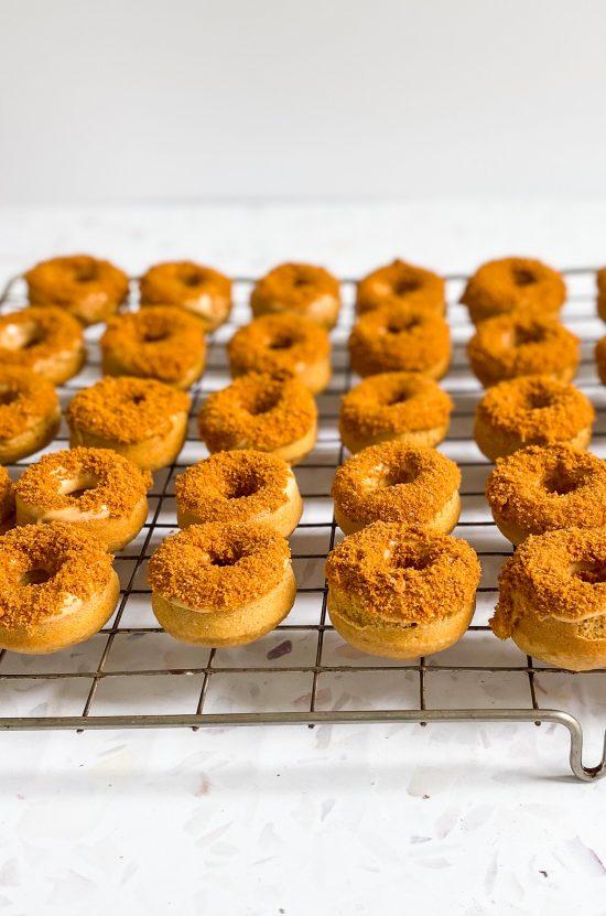 Rows of Mini Biscoff Baked Doughnuts with Biscoff Glaze - www.foodnerd4life.com