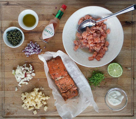 The ingredients to make a tartare of marinated trout and smoked salmon with apples and aged cheddar cheese