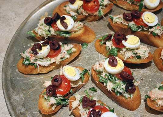 Crab and Watercress Tapas, Garnished with Black Olives, Cherry Tomatoes and Hard-Boiled Quail Eggs
