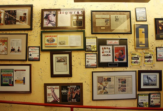 "A very full ""press wall"" greets customers at Tony Caputo's, Salt Lake City."