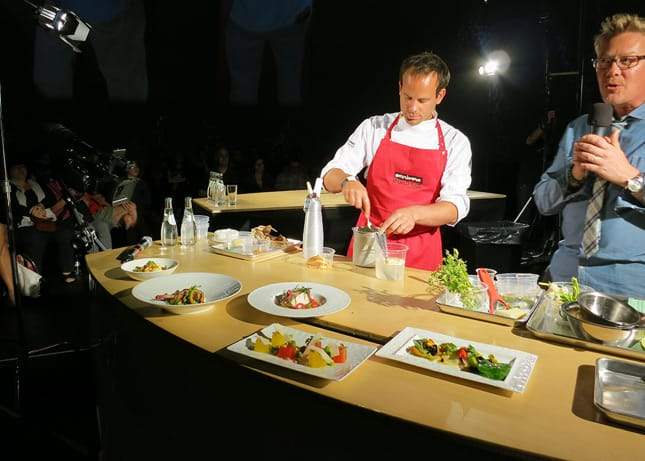 Chef Gregory Marchand (Frenchie, Paris) surrounded by his five colorful dishes at the Omnivore Food Festival, Montreal / FoodNouveau.com