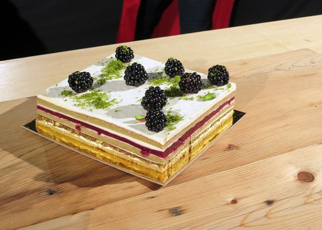 Chef Stéphanie Labelle's layered cake made of pistachio cake, pistachio praline, melon cream, blackberry jelly, fresh blackberries and brushed pistachios. At the Omnivore Food Festival, Montreal / FoodNouveau.com