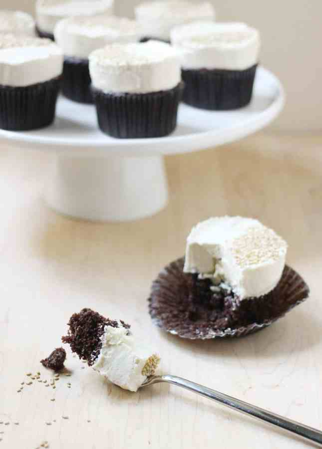 Cupcake fatigue? This recipe is your remedy. The tahini buttercream is slightly nutty and perfectly fluffy: a perfect match to the dark chocolate cupcakes! // Dark Chocolate Cupcakes with Tahini Buttercream // FoodNouveau.com