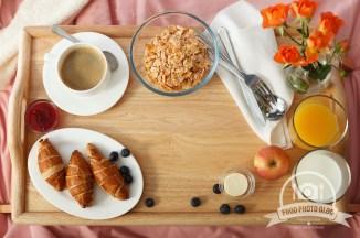 Breakfast served in bed on wooden. Copyspace