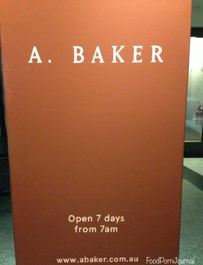 A Baker New Acton sign