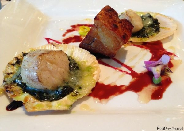 Crispy skin pork belly with pesto au gratin Queensland scallops