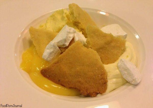 Deconstructed lemon tart with whipped cream and lemon soufflé