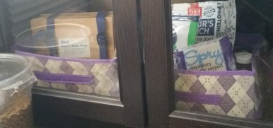 $ Tree Fabric baskets in a wonderful storage cabinet. One for dog/cat treats, one for hiking things. There's another $ Tree basket in the corner with pet supplements.
