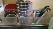 over the sink bins, dish clothes, rubber jar thingy and sink drain basket all from the $ Tree