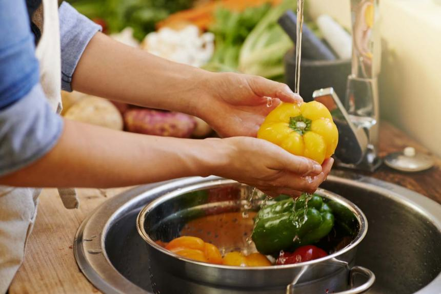 hands washing bell peppers