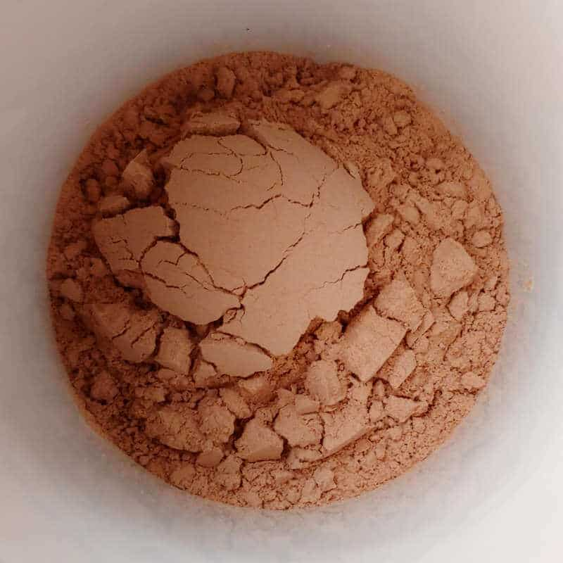 cocoa mix for Alton Brown's hot cocoa mix, in a mug, after being ground to a fine powder