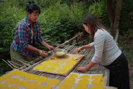 Mandalay Mango Farmer Group women using the new drying racks for mango leather production   Photo courtesy of Winrock