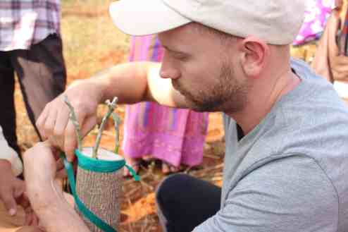 F2F volunteer, Todd Walton, demonstrating grafting techniques.   Photo courtesy of Winrock
