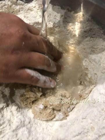 Start mixing the flour toward the center