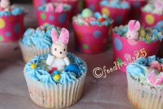 Arrange the treats, eggs and marshmallow bunnies on cupcakes