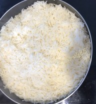 Cook till the water evaporates and rice is cooked
