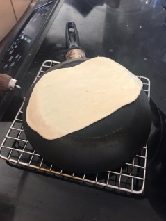 Cook naan till the bubbles appear on the surface