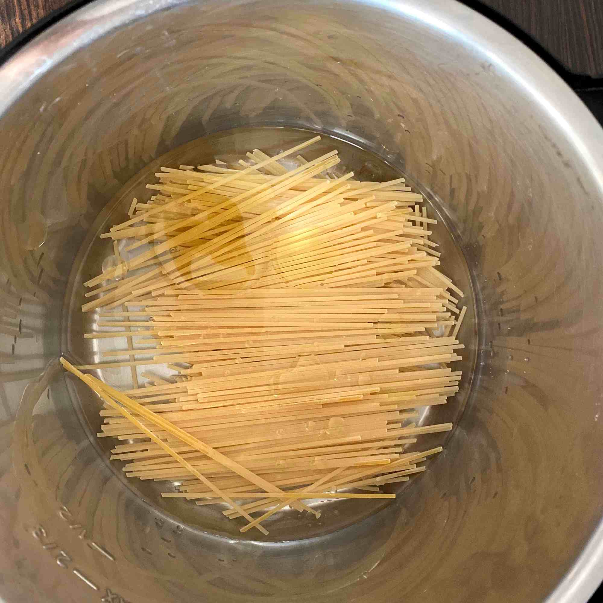 Add Spaghetii with little salt and water in inner pot of IP