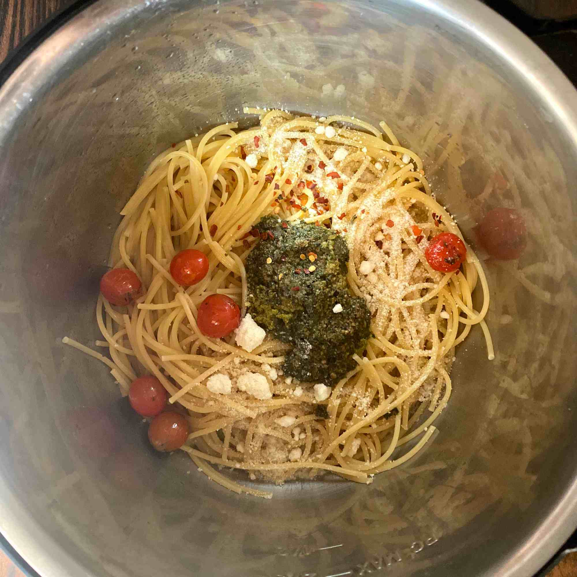 Let Spaghetii cool a bit , then add Basil Pesto, roasted tomatoes and cheese