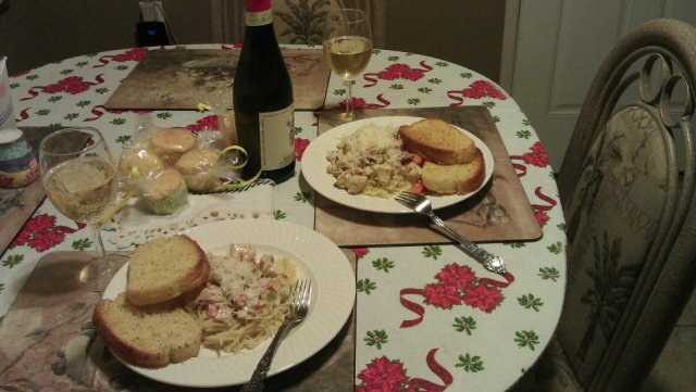 Creamy pasta and garlic bread with wine and home made corn muffins