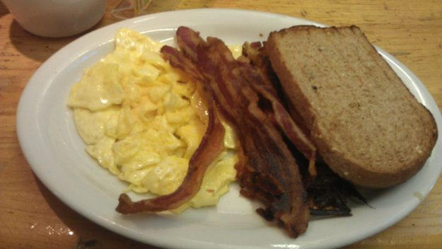 The Regular two eggs any style served with choice of bacon or sausage, hash browns & our o.s.m. toast