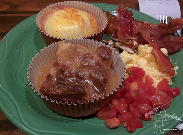Eggs Benedict, Cake pudding, Bacon, Scrambled eggs, Tomatoes, and mushroom for breakfast
