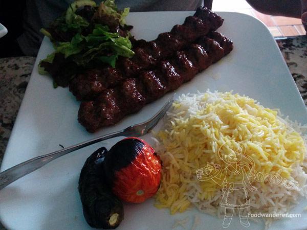 Beef Koobideh, roasted tomato, salad, Saffron rice