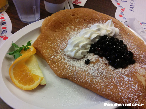 Paula's Special Danish Pancake topped with blueberries and whipped cream