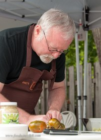 Bret prepping unripe heirloom tomatoes