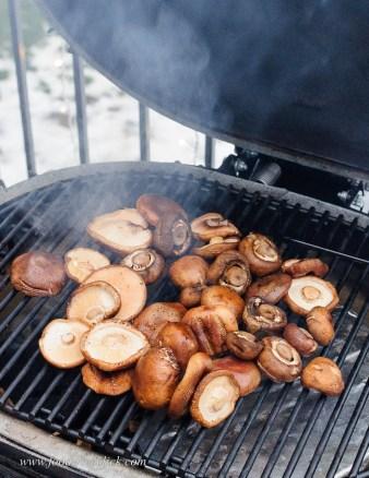 mushrooms smoking on a Primo grill