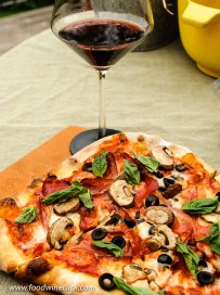 Finish the pizza with fresh basil!