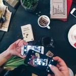foodies taking photos with iphone while traveling