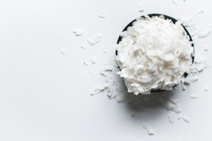 shredded white coconut on white background