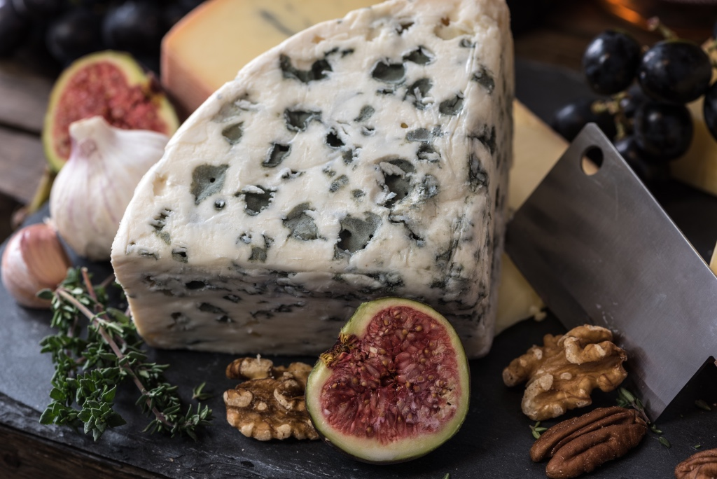 blue cheese walnuts and figs on a cheese board