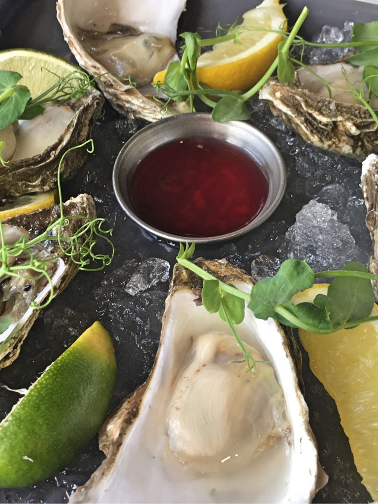 oysters in ice with lemon wedges