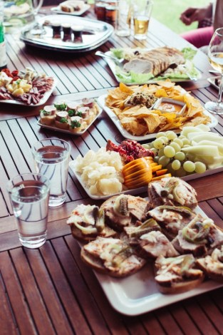 outdoor party food party platters on wooden table